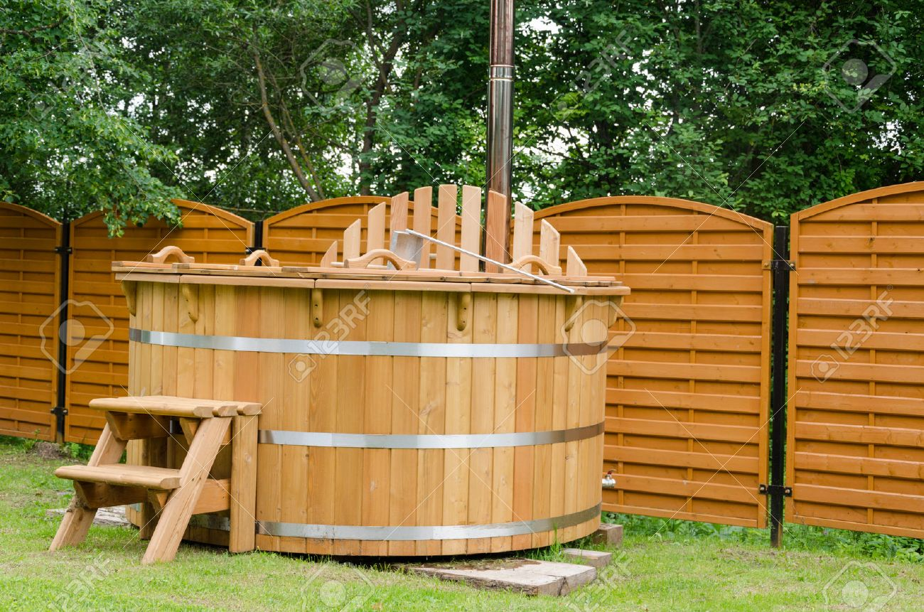high diameter heated tub with hot x electric barrel jets pin wood and