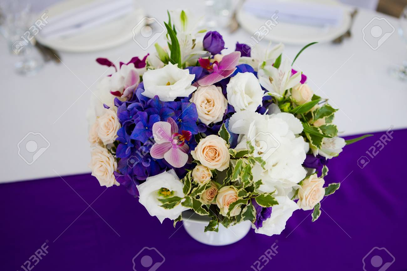Wedding Table Setting With Flowers Blue White Red
