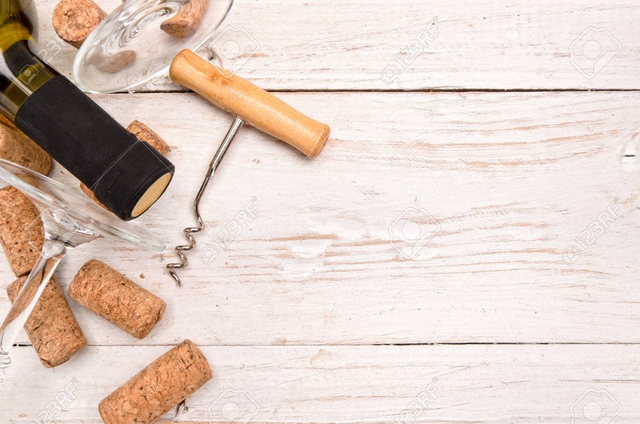 Bottle Of Wine, Corkscrew And Corks On Wooden Table. Background Stock Photo    46728858
