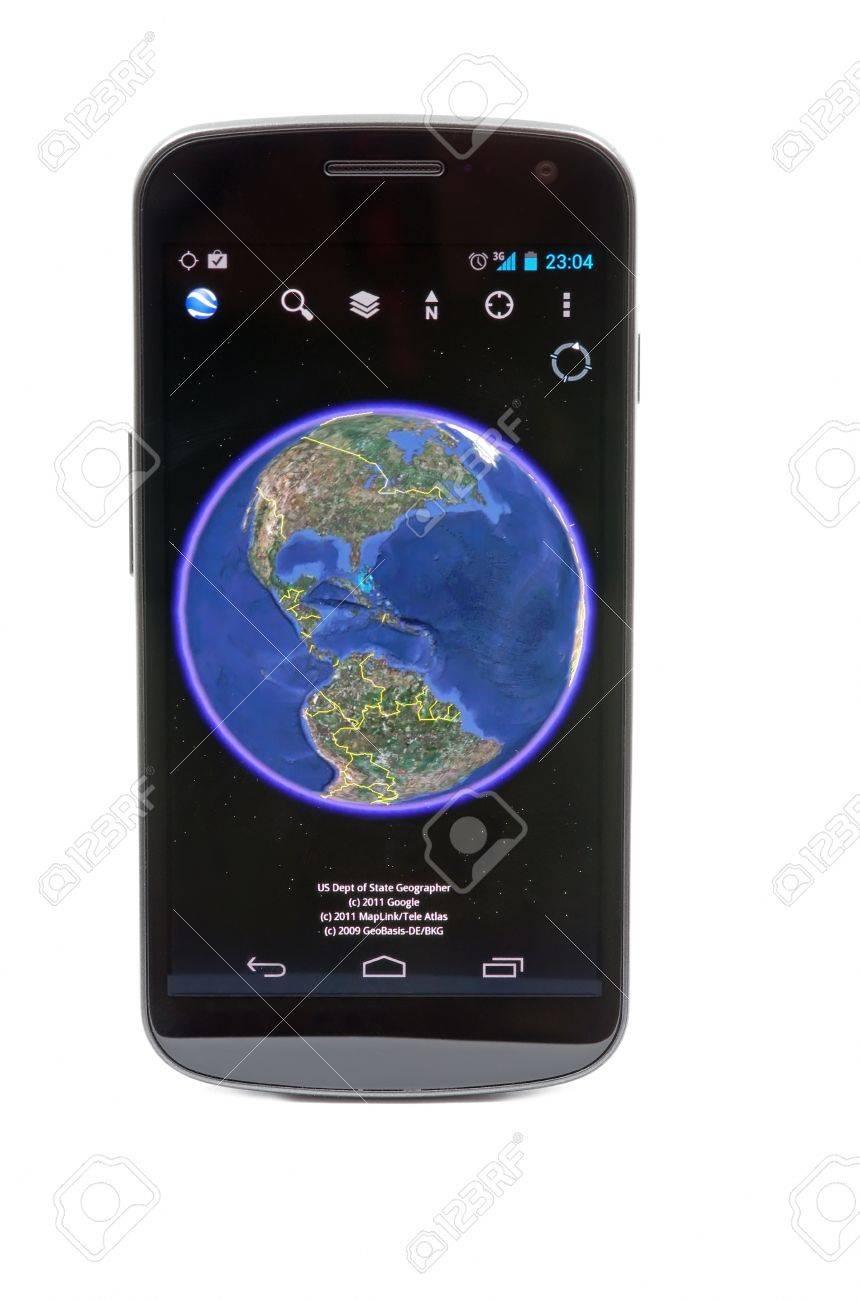 Bucharest - 15 december 2011 - Google Earth on Samsung Galaxy Nexus Stock Photo - 13512340