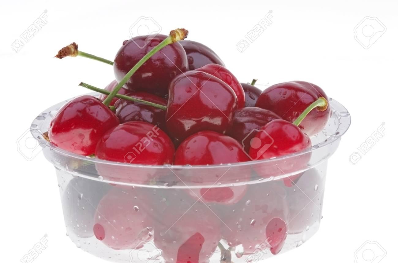 Fresh cherry in a plastic box, over white Stock Photo - 21011294