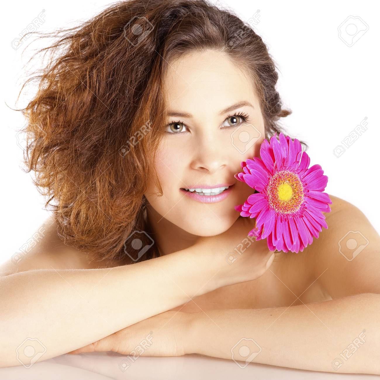 Girl with a flower on a white background in the studio Stock Photo - 12685090