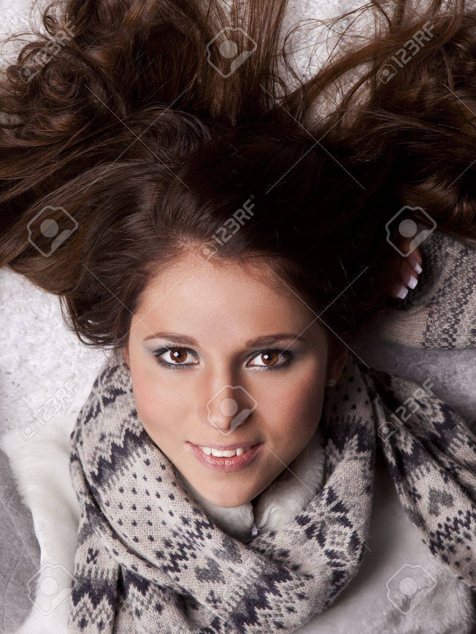 young woman with a scarf around his neck, his hair disheveled Stock Photo - 12922242