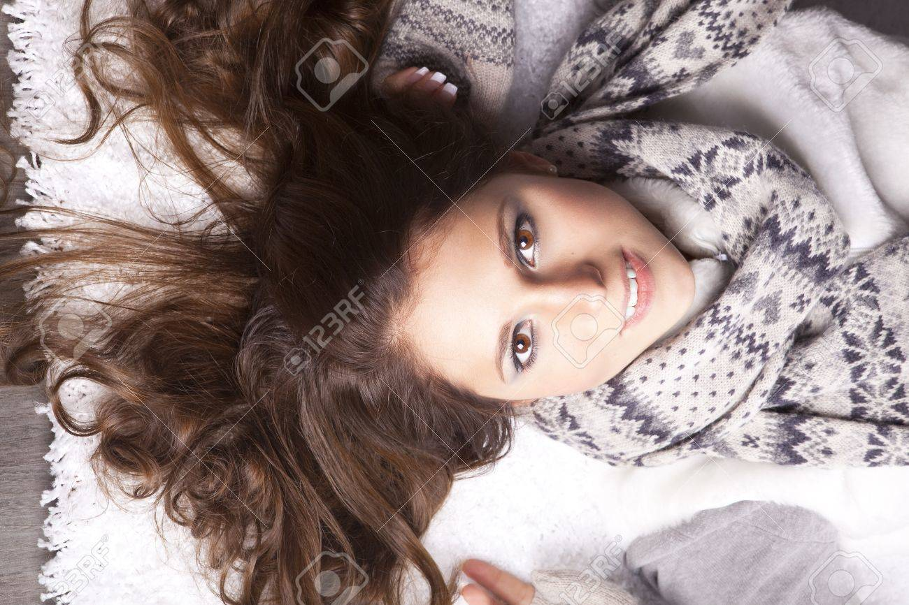 young woman with a scarf around his neck, his hair disheveled Stock Photo - 12922256
