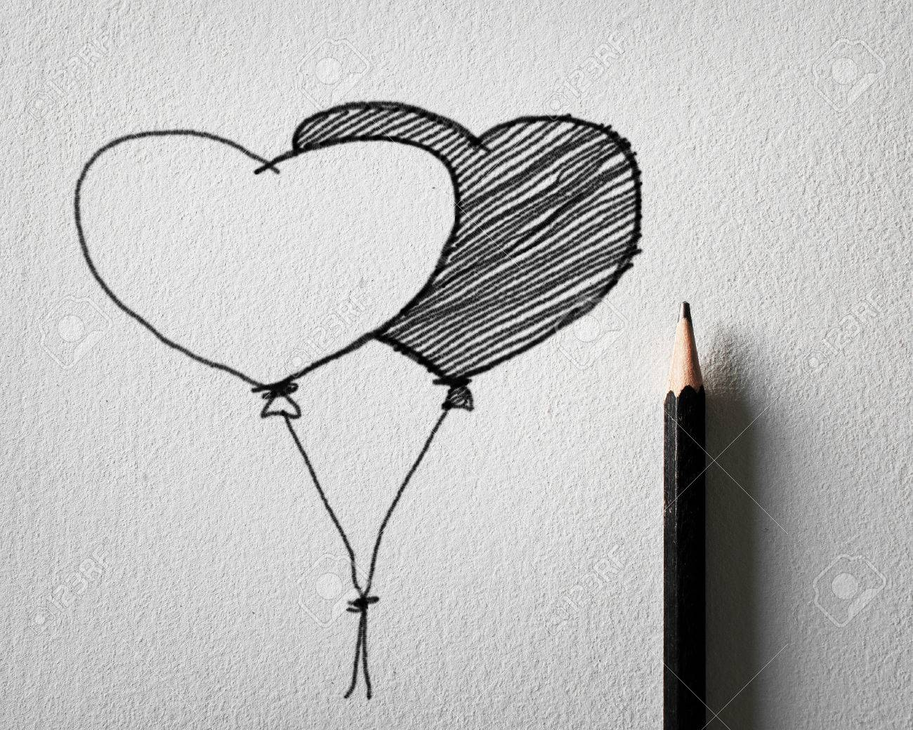 Pencil sketching for heart balloon concept on white paper stock photo 23468644