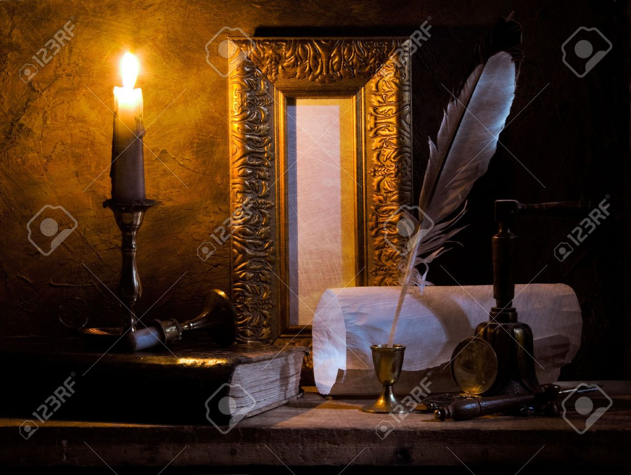STILL-LIFE.Old paper with a candle and a quill pen Stock Photo - 10872264
