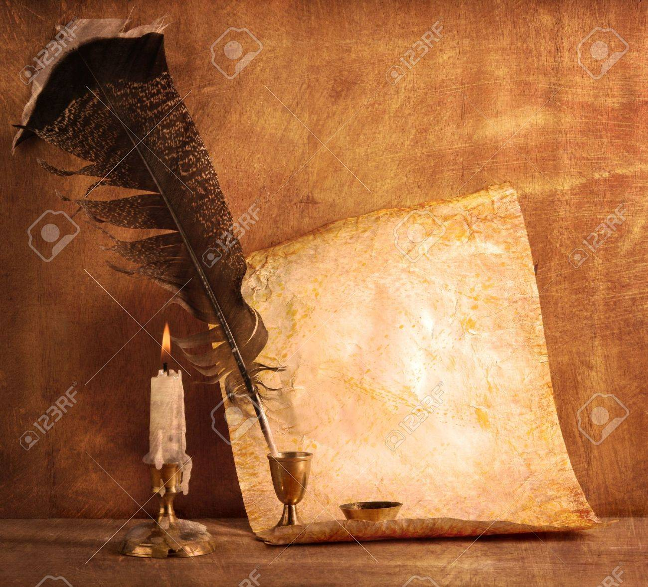 Old paper with a candle and a quill pen Stock Photo - 11085111