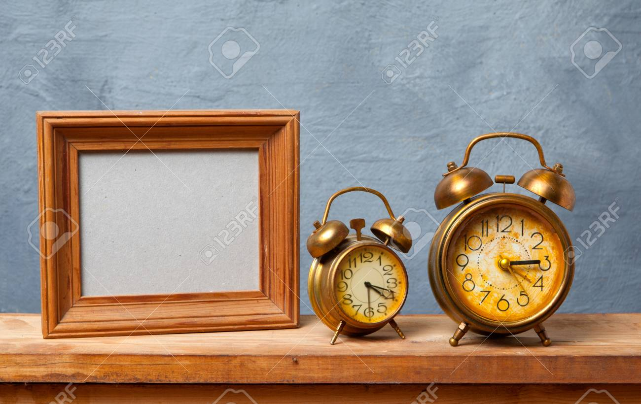 Vintage alarm clock on the table with photo frame stock photo vintage alarm clock on the table with photo frame stock photo 39570325 jeuxipadfo Image collections