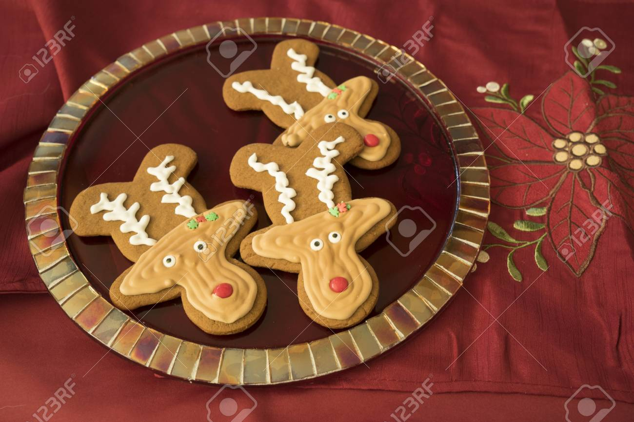 Gingerbread Reindeer Cookies With Perfect Royal Icing On Red