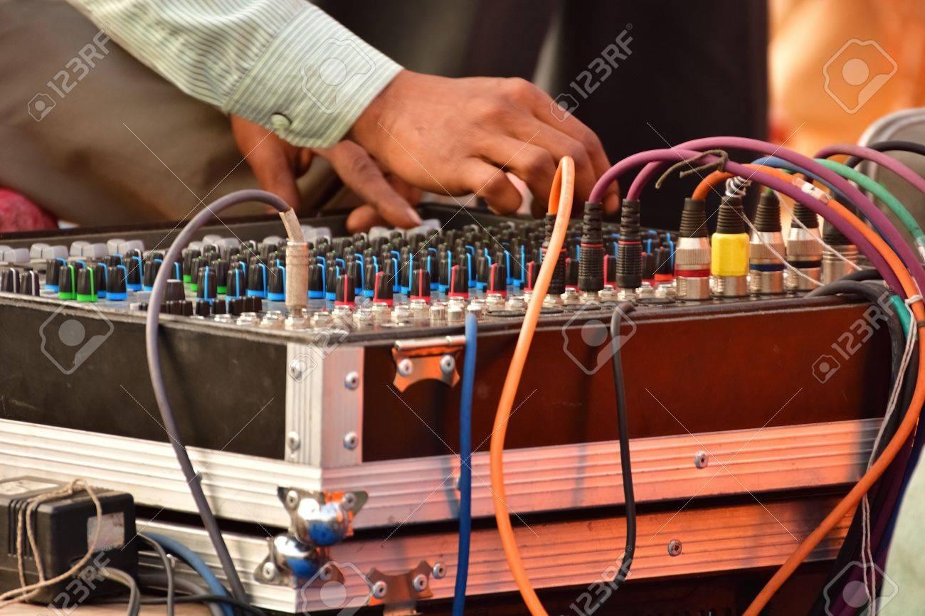 Audio mixer, music equipment in a live concert  Adjusting audio