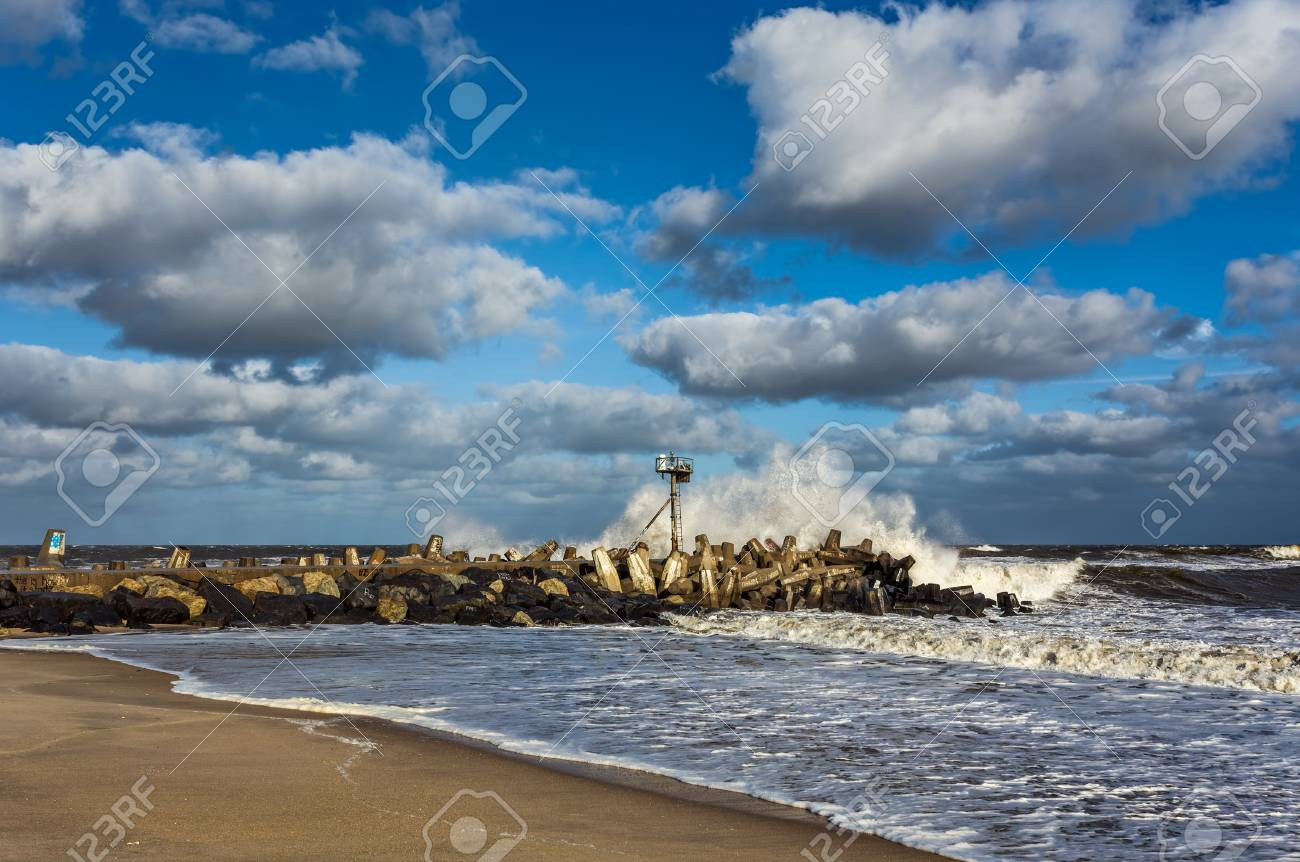 a wave crashing on a jetty in point pleasant nj at manasquan