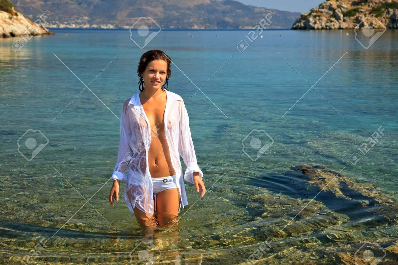 Beautiful young woman on the beach Stock Photo - 6410969