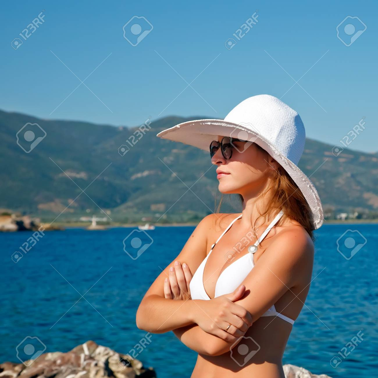 Outdoor portrait of young woman in white hat Stock Photo - 7089012
