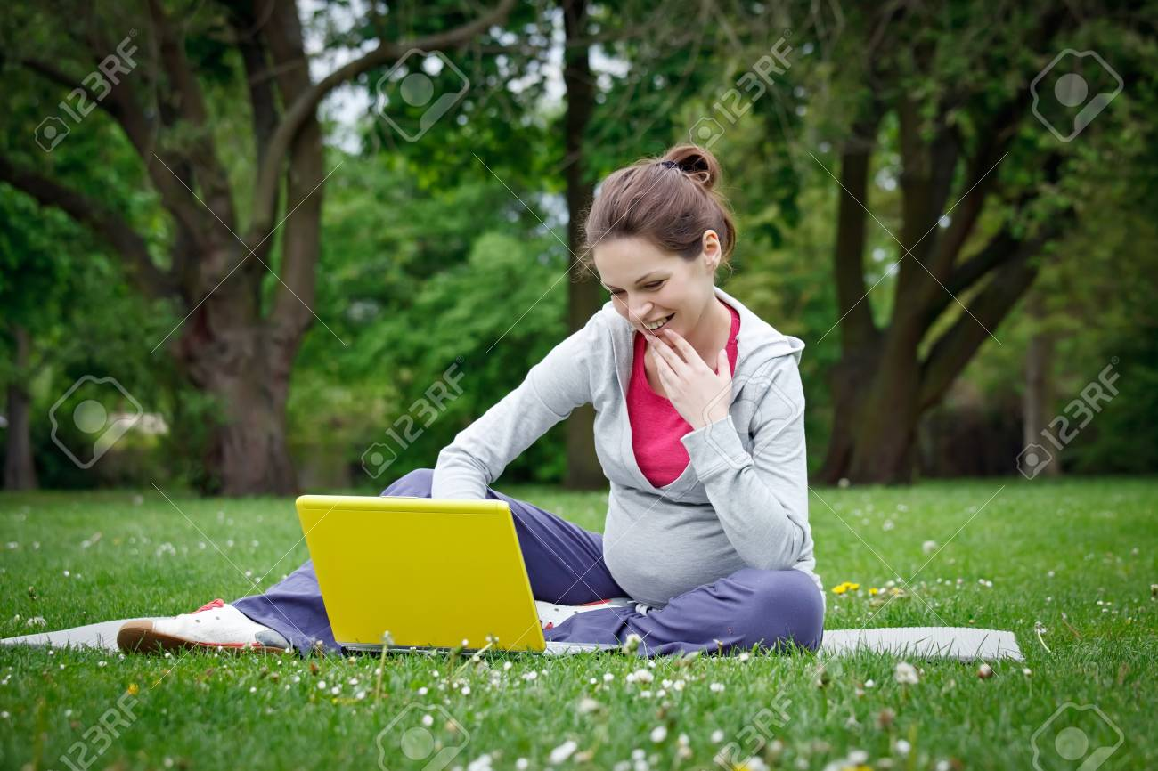 Beautiful pregnant woman in the park Stock Photo - 7553088