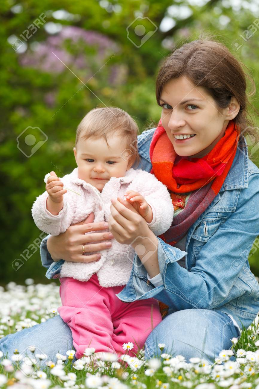 Mother with baby playing in the park Stock Photo - 9696184