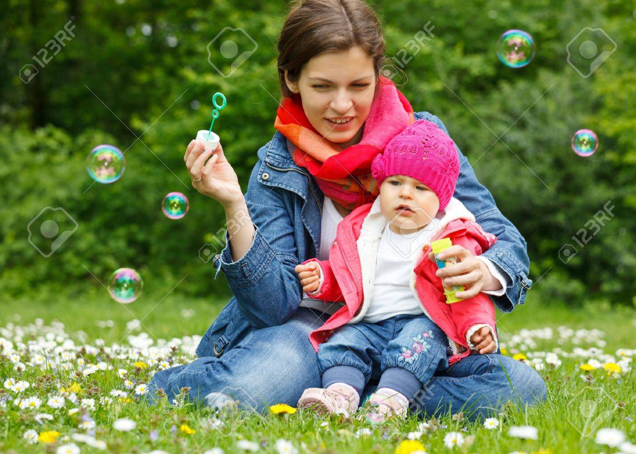 Mother with baby playing in the park Stock Photo - 9696178