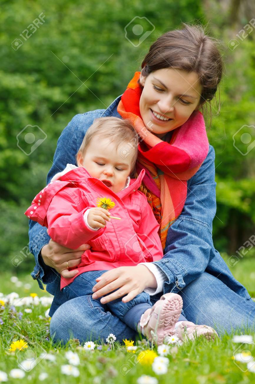 Mother with baby playing in the park Stock Photo - 9791348