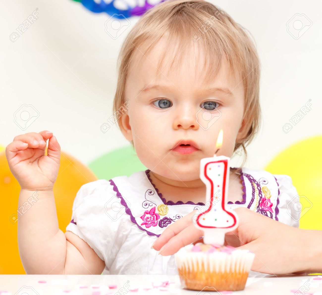Little girl celebrating first birthday Stock Photo - 10243336