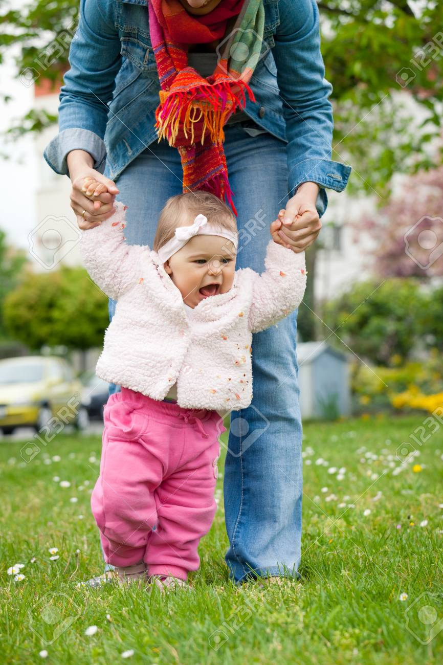Baby s first steps Stock Photo - 14745992
