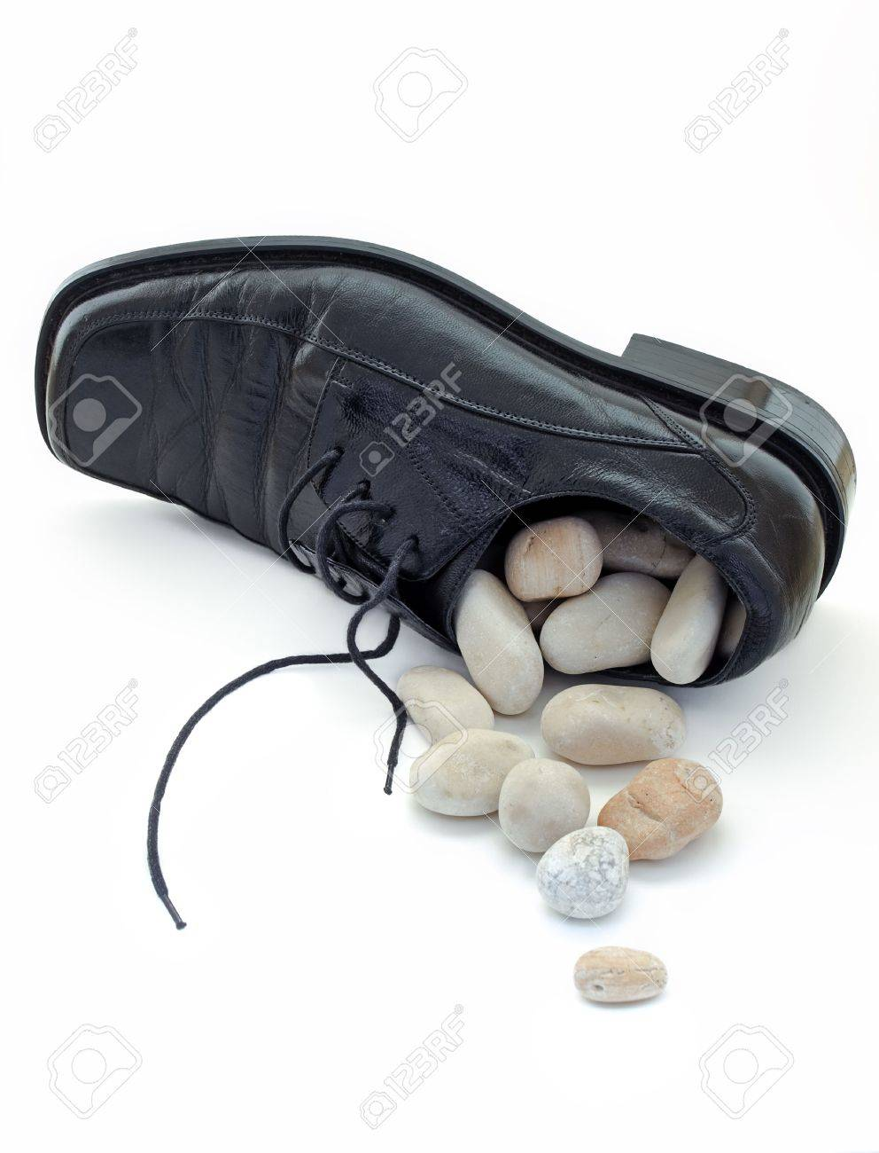 Metaphor about problems like  small stone at the bottom of shoe.What to do when it is full, and they are no longer small Stock Photo - 4621435