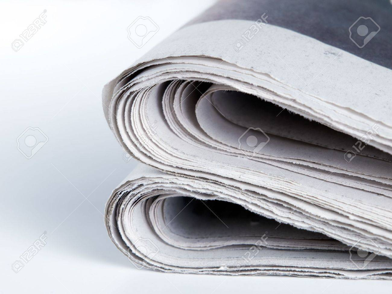 Folded edges of the  newspaper on a clear background. Stock Photo - 5815251