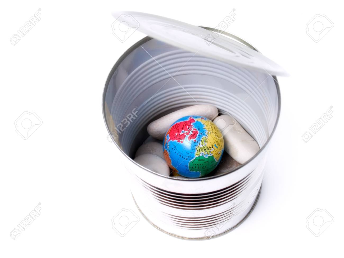 Earth globe mixed with stones in a conservator on a white background Stock Photo - 7700443