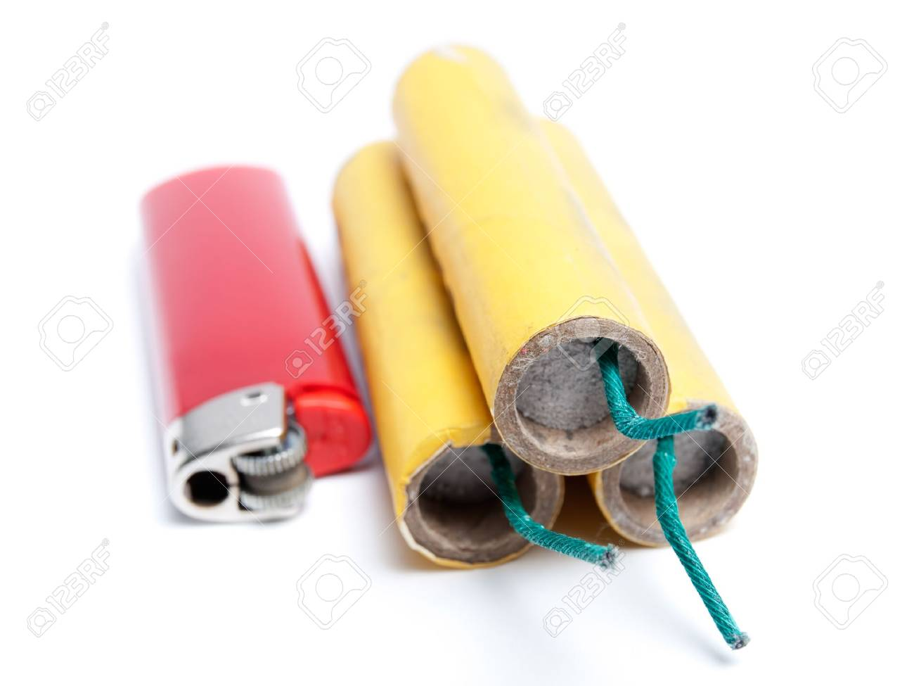 Three firecrackers and lighter on a white background. Stock Photo - 11746940