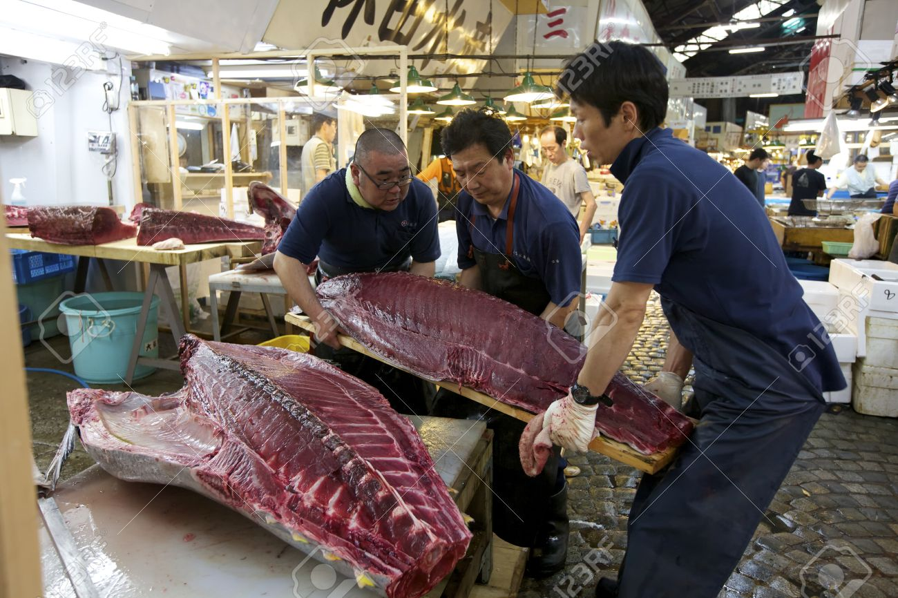 Stock Photo Tokyo July 4 Workers Processing Tuna At The Tsukiji Wholesale Seafood And Fish Market In Tokyo Japan On July 4 2011