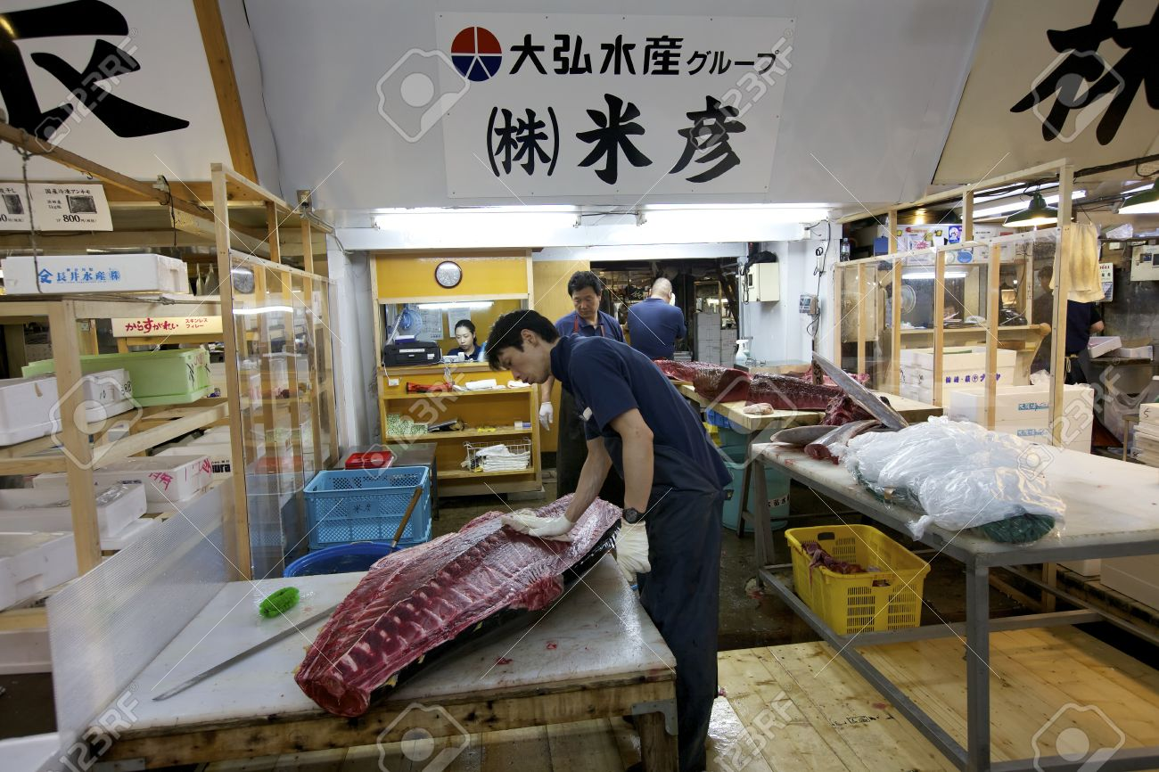 Stock Photo Tokyo July 4 Worker Processing Tuna At The Tsukiji Wholesale Seafood And Fish Market In Tokyo Japan On July 4 2011