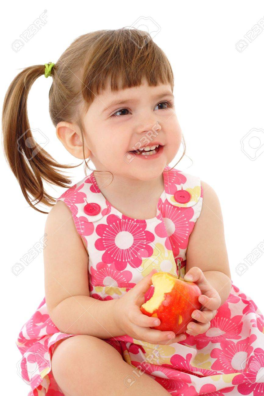 Smiling little girl with apple, isolated on white Stock Photo - 9333871