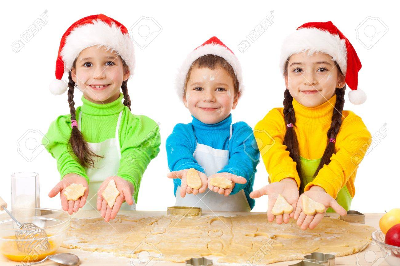 Three Smiling Kids Showing Christmas Cooking Isolated On White