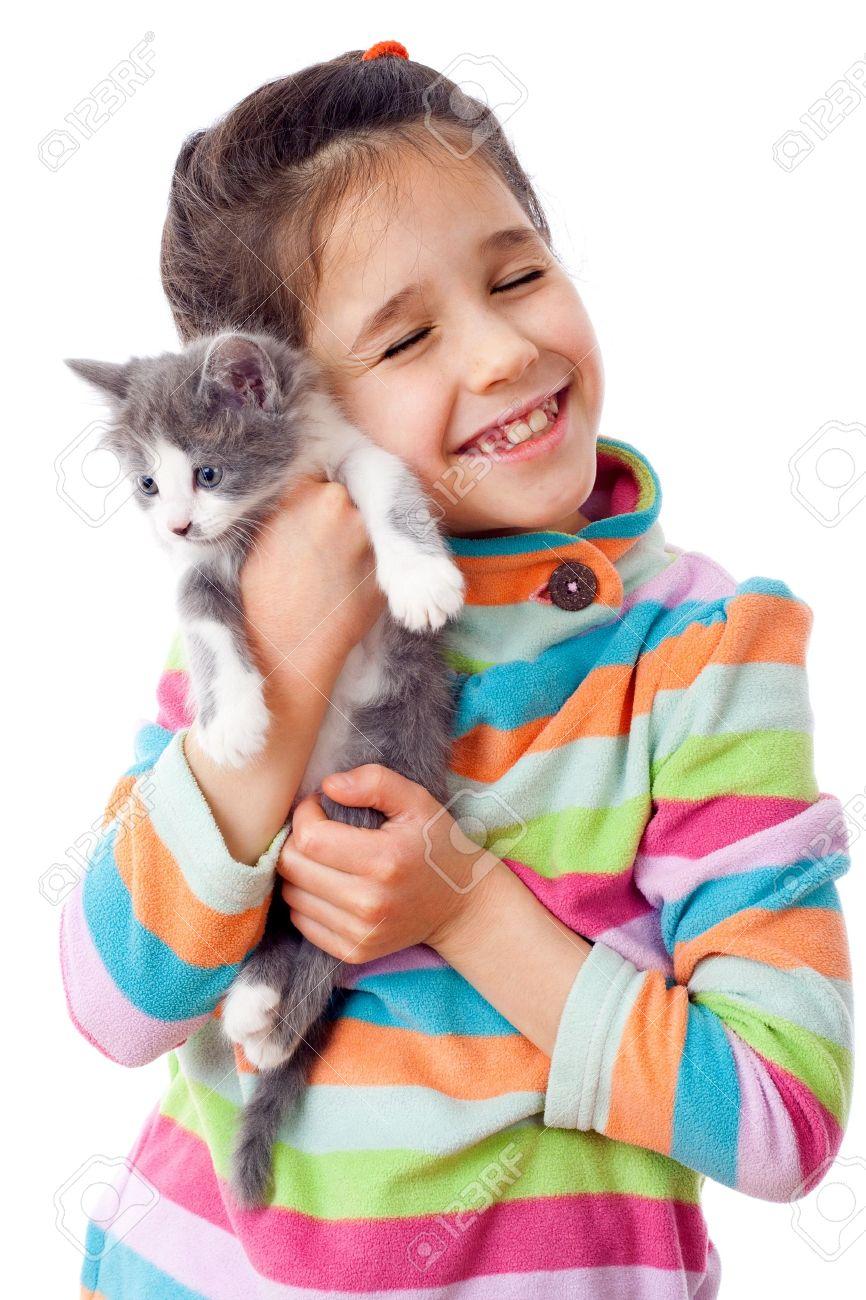 Happy little girl cuddle kitten, isolated on white Stock Photo - 12084325