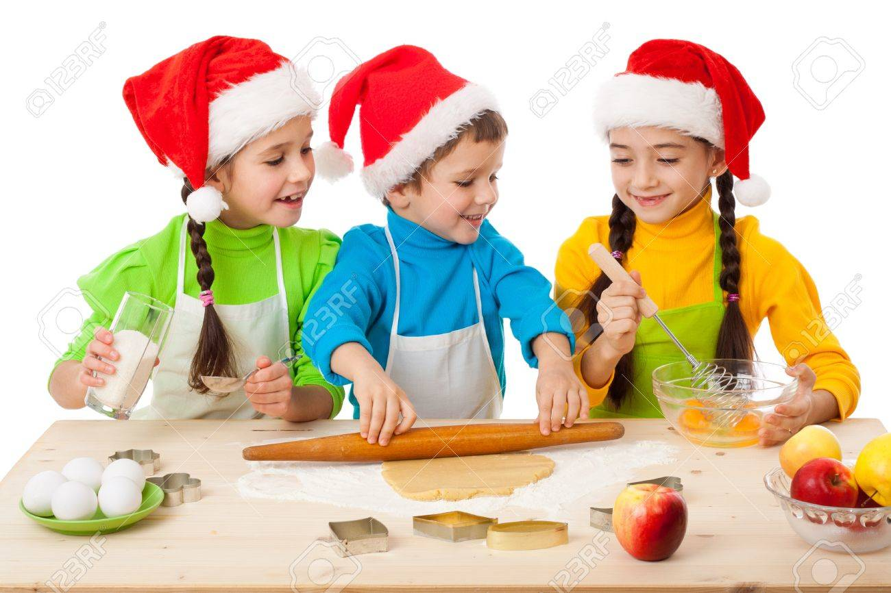 Three Smiling Kids With Christmas Cooking Isolated On White