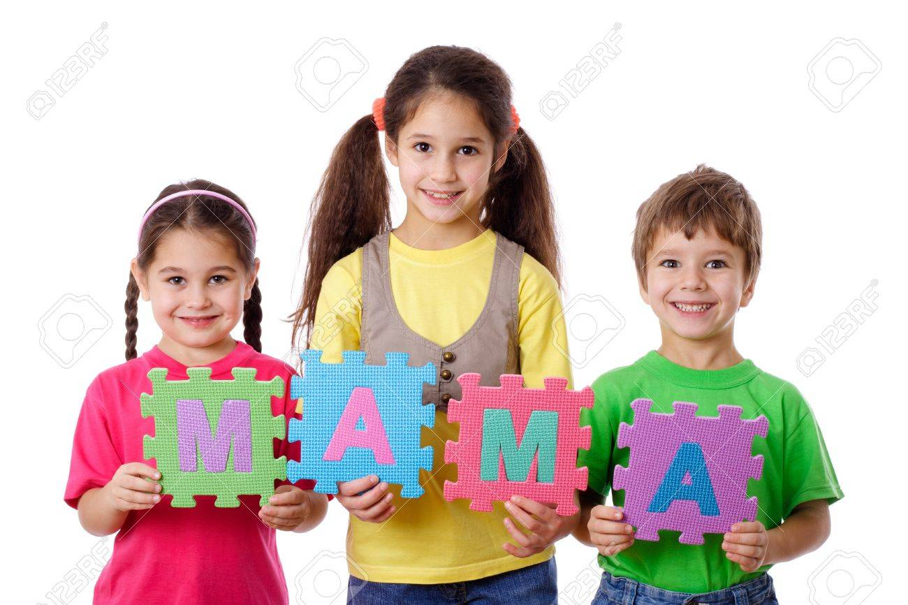 Three kids with colorful letters displays the word Mom, isolated on white Stock Photo - 17193945