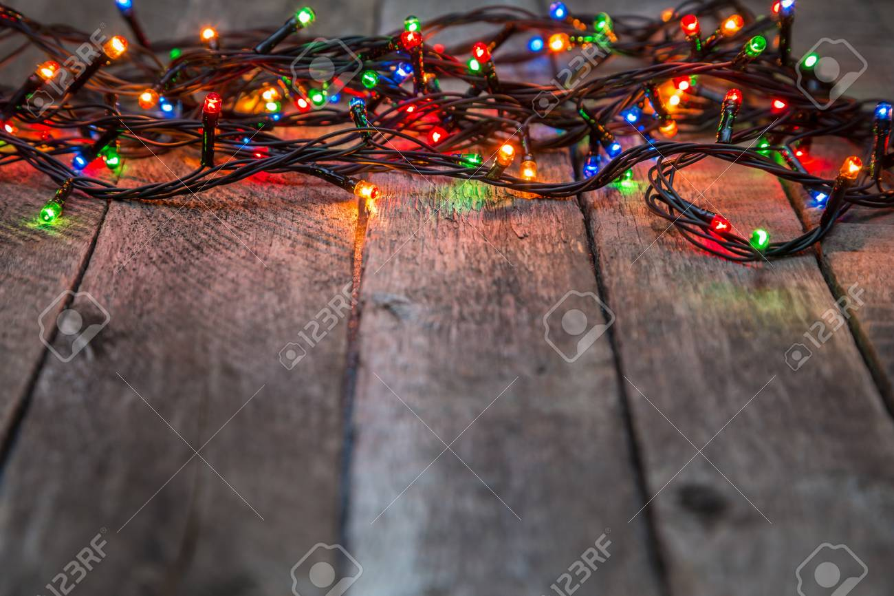 Christmas Lights On Wooden Background Abstract Template With