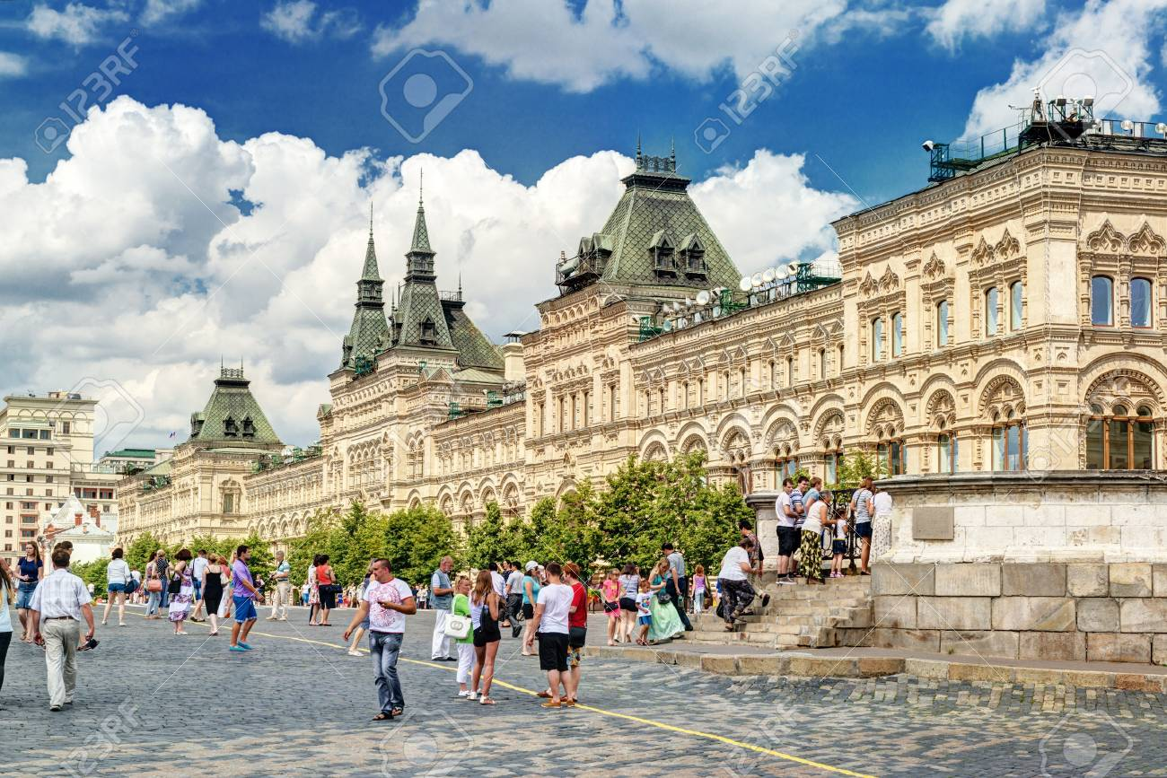 Tourists walk on Red Square near the GUM department store on july 13, 2013 in Moscow, Russia  Stock Photo - 21154809