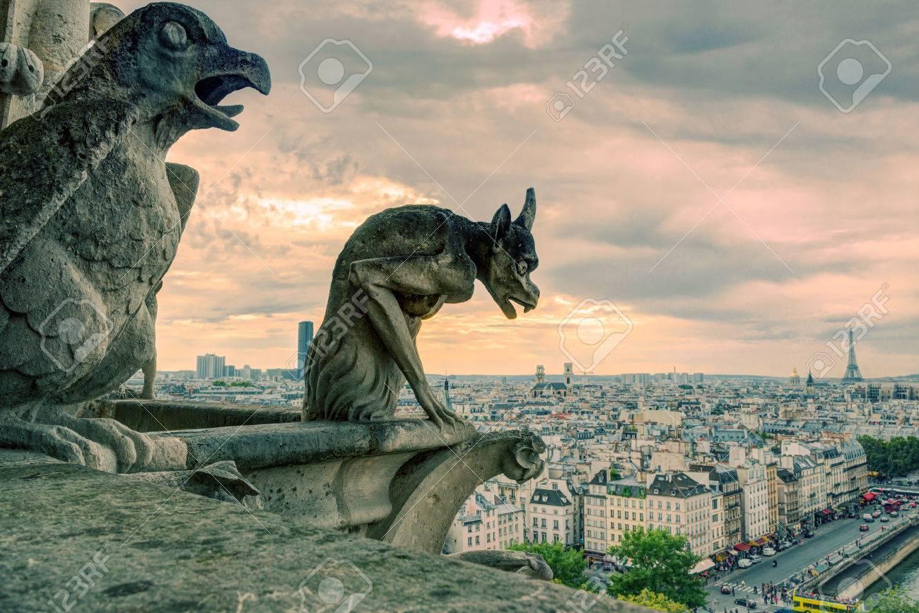 Chimeras gargoyle of the Cathedral of Notre Dame de Paris overlooking Paris, France - 24201037