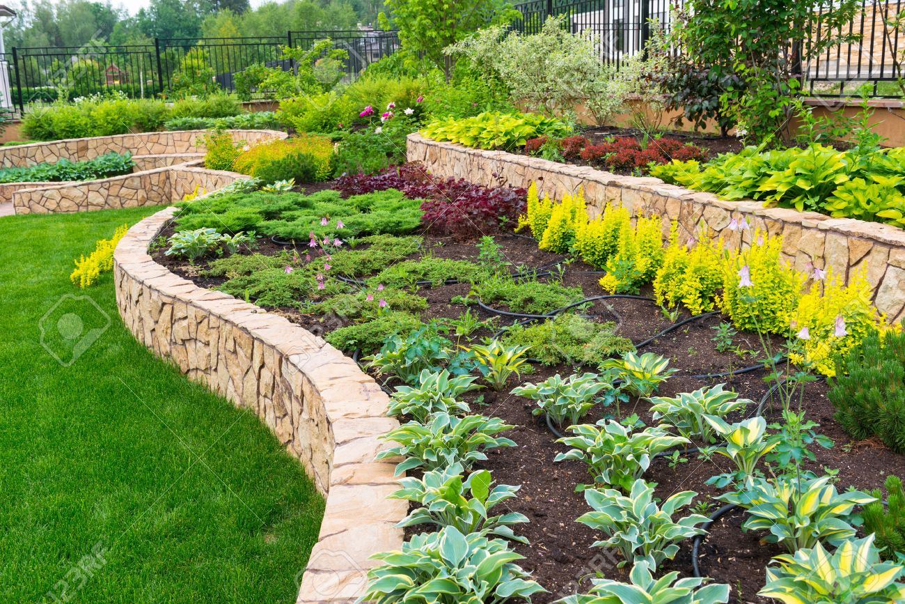 Garden Design With Natural Stone Landscaping In Home Garden Stock Photo  Picture And With Backyard.