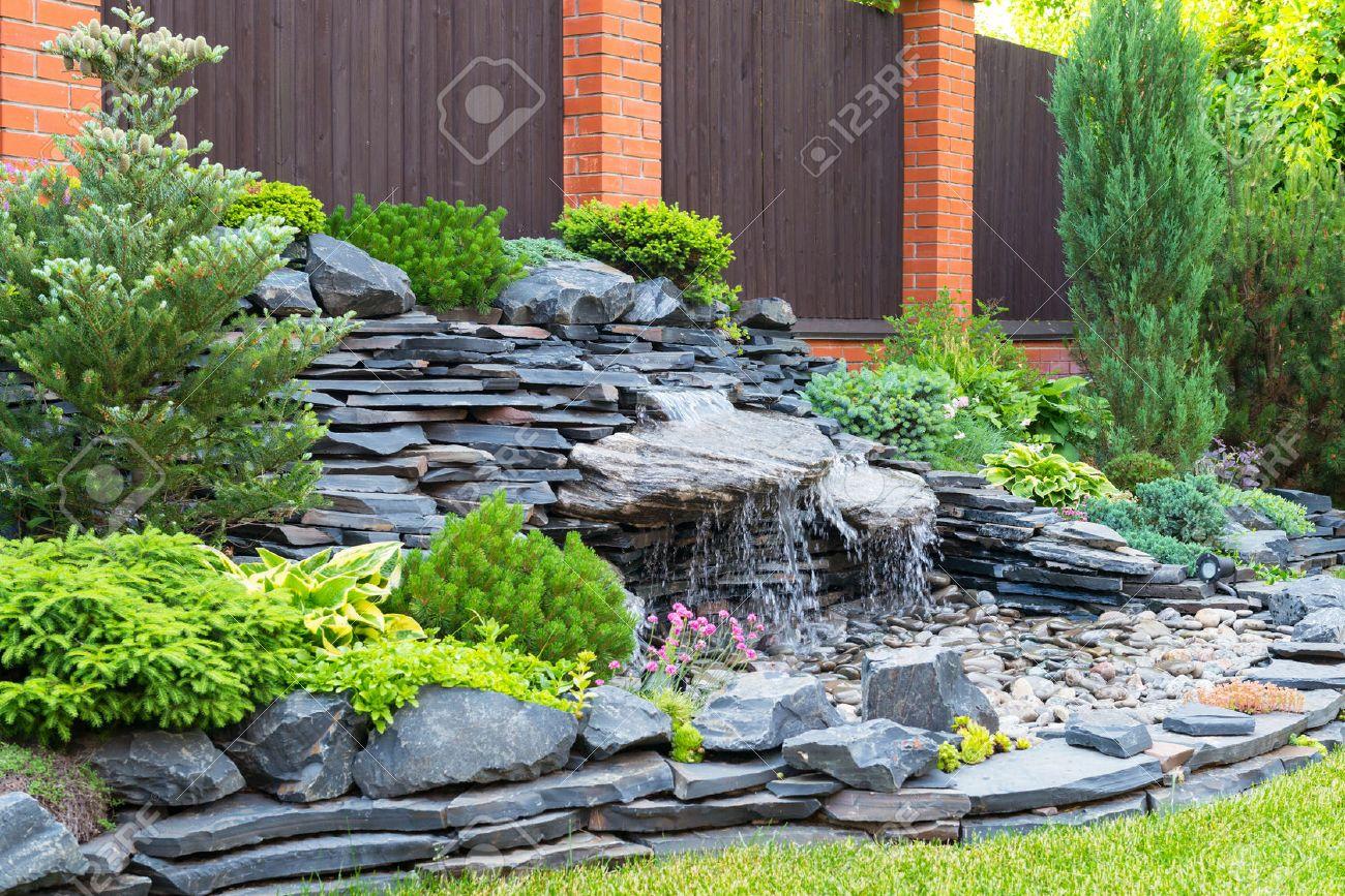 Home garden landscaping - Natural Stone Landscaping In Home Garden Stock Photo 29763130