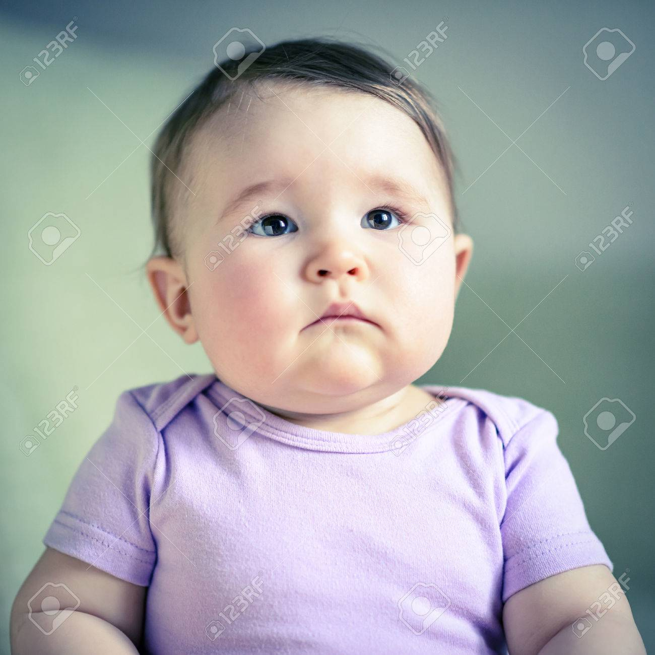 Stock photo thoughtful and serious nice baby girl child close up