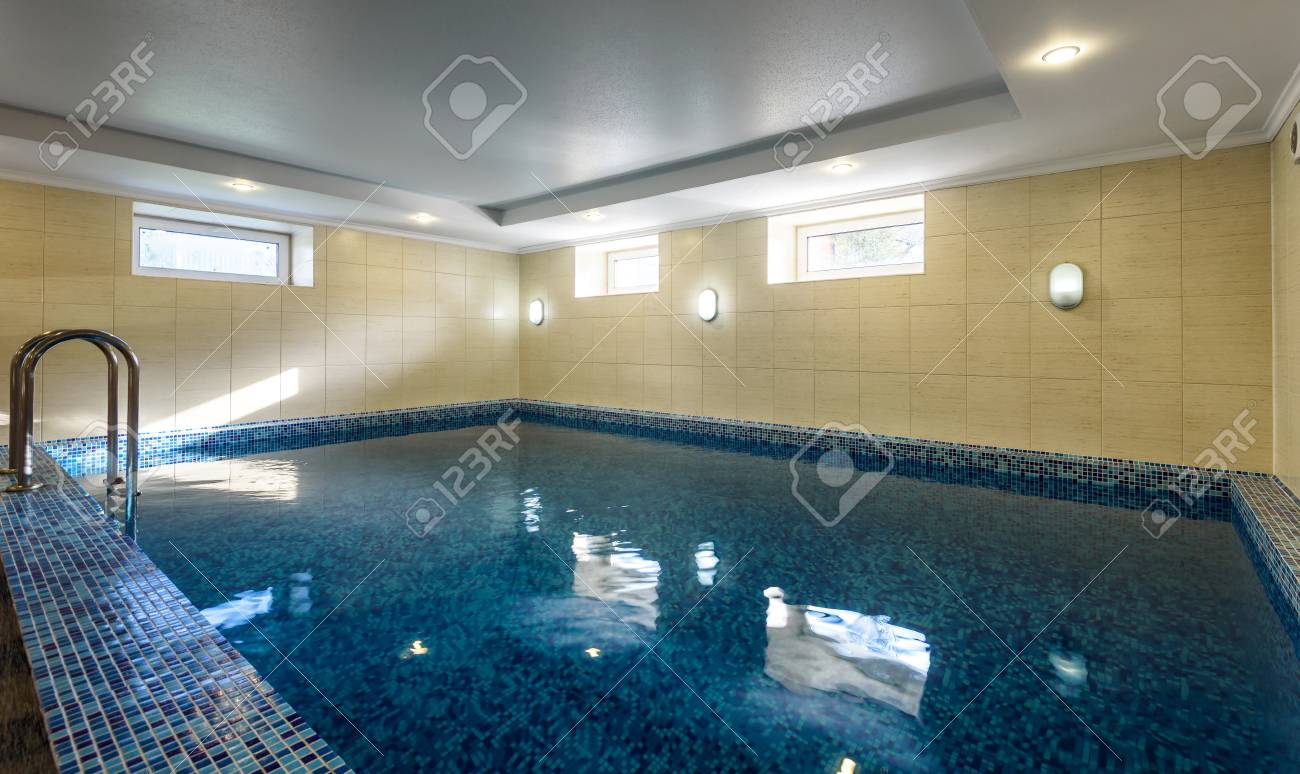 Swimming pool in hotel or residential house. Modern pool interior..