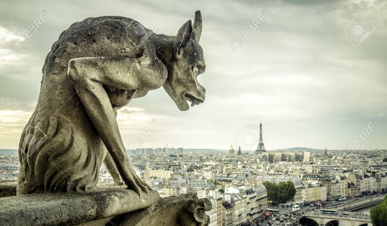 Gargoyle Or Chimera On The Cathedral Of Notre Dame De Paris Looks ...