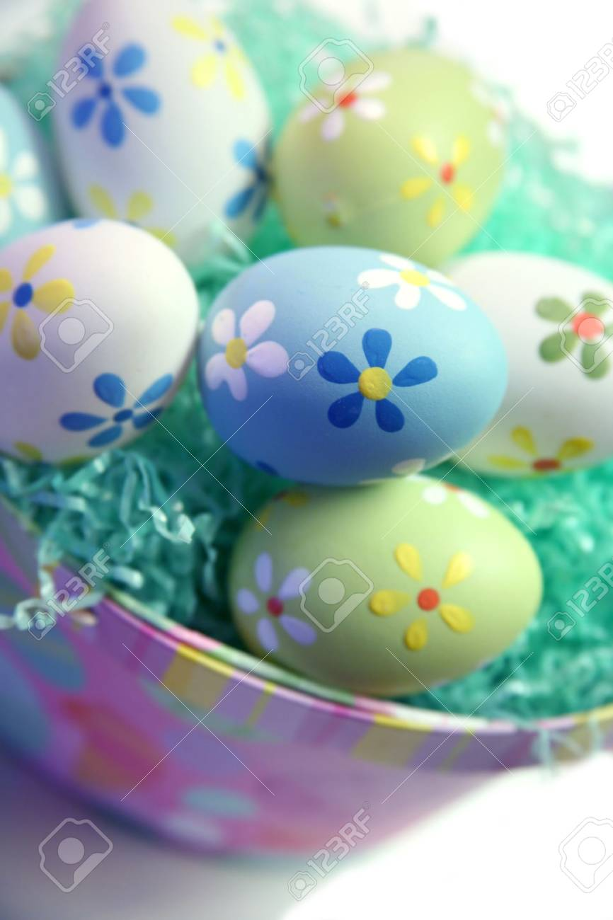 Colorful Easter Eggs in Grass with Basket Stock Photo - 1980169