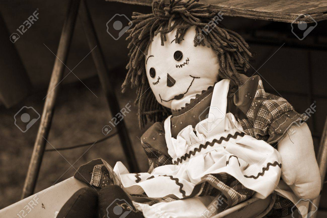 old raggedy ann doll in sepia tone stock photo picture and