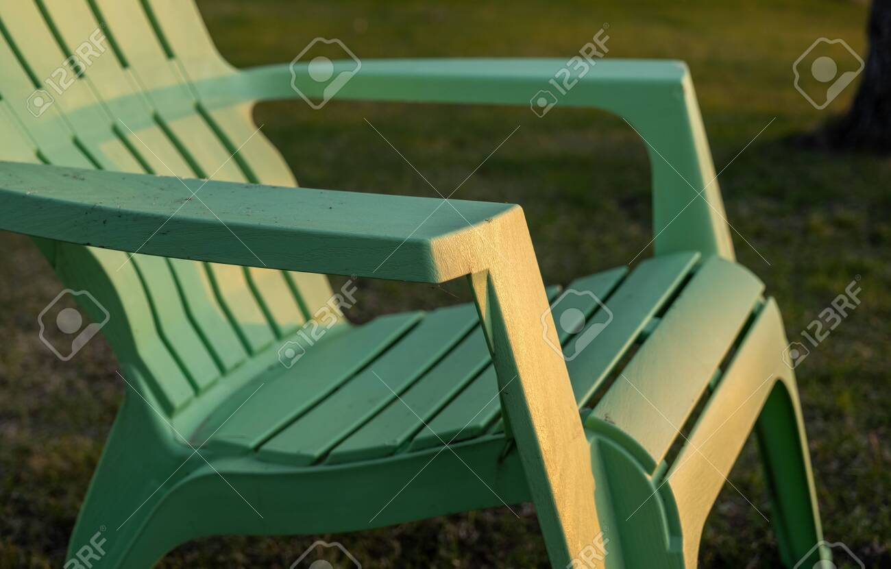 Picture of: Closeup Of A Lime Green Plastic Resin Adirondack Chair Sitting Stock Photo Picture And Royalty Free Image Image 147584729