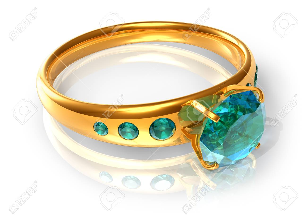 Golden ring with emeralds Stock Photo - 9535594