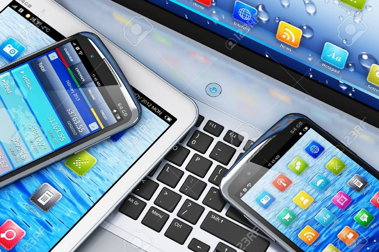 macro view of tablet computer and touchscreen smartphones with colorful interfaces on laptop notebook PC Stock Photo - 18709131
