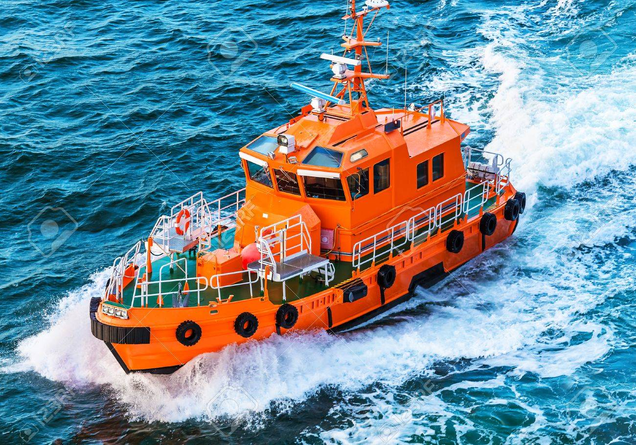 Orange rescue or coast guard patrol boat industrial vessel in blue sea ocean water - 44256016