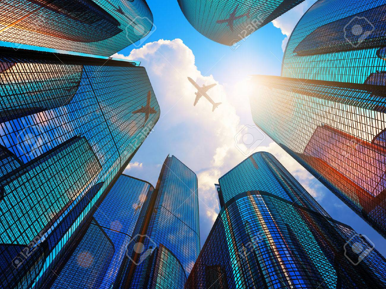 Creative abstract business corporate construction industry and real estate financial concept: blue modern high tall glass reflective skyscrapers in city downtown district with sun light and airliner - 44559554