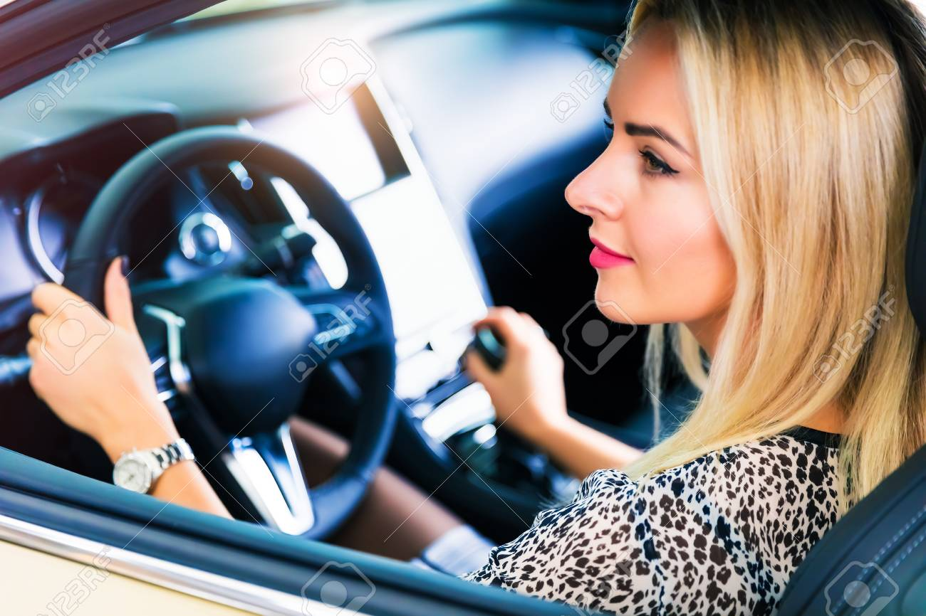 Young Woman Driving A Modern Luxury Car Stock Photo Picture And